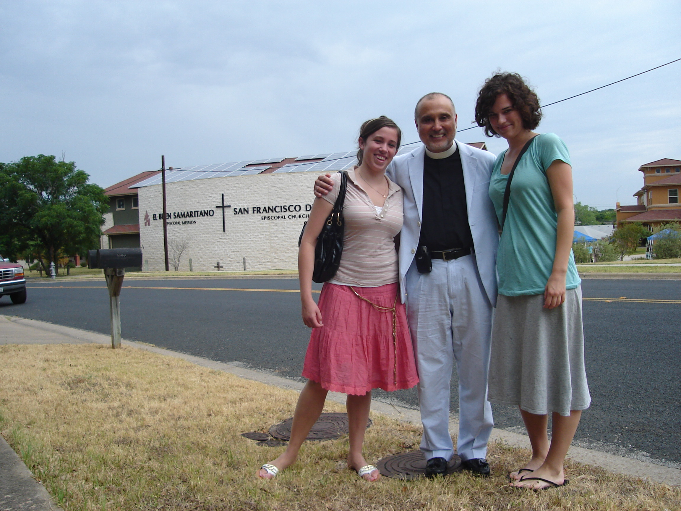 Adrien and I with Reverend Jose Palma--if you look closely you can see the solar panels forming a cross on the roof of the church building behind us