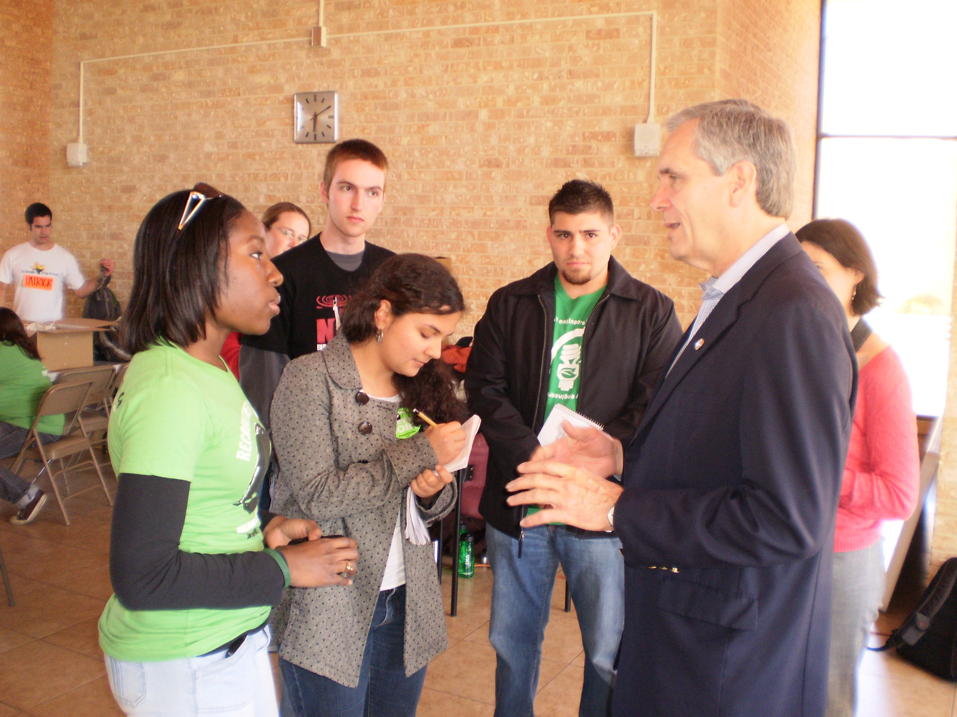 Aggie Adrienne Jones (seen here talking to US Rep. Lloyd Doggett) sent a letter supporting SB 2182