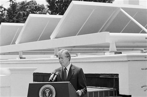 President Jimmy Carter speaks against a backdrop of solar panels at the White House Washington on June 21, 1979.