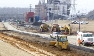 2014-02-04 Re-enforcing and patching the berm to the ash basin at the Duke Energy Dan River Steam Station in Eden, N.C.Joseph Rodriquez - News & Record