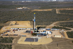 Oil drilling site, with pond for fracking water, Cotulla, TX  Photo by Al Braden
