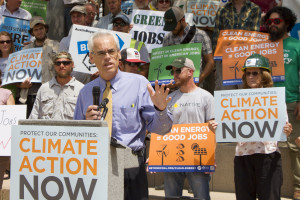 Councilman Riley spoke about the need to action at Tuesday's Affordable Energy Rally in front of City Hall.  Photo by Al Braden.