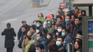 China's worsening air pollution has exacted a significant economic toll, grounding flights, closing highways and keeping tourists at home. Photograph from STR/AFP/Getty Images