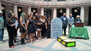 Activist mourned the death of local control at the Texas capital.  Photo by Carol Geiger.