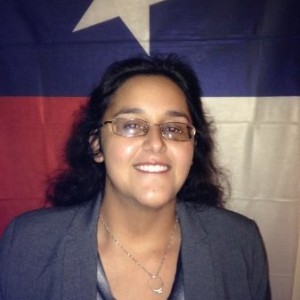 Hillary Corgey in front of Texas Flag