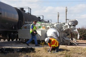 Crews work to clean up a wreck after an 18-wheeler collided with a train at the HWY 290 frontage road and Tegle Road Friday, Jan. 25, 2013, in Cypress, TX. (Cody Duty / Houston Chronicle)