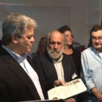 "Texas director, Tom ""Smitty"" Smith accepting a proclamation from City of Austin Mayor, Steve Adler."